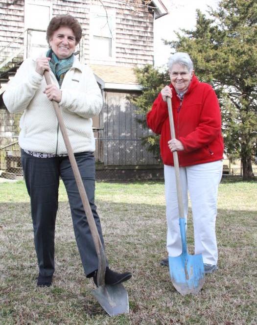 Marie Marole and Carol Wells break ground on the community garden